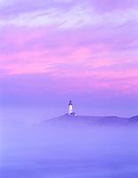 S00054M.tiff    Yaquina Lighthouse, fog and sunrise. Oregon