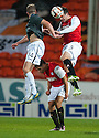 Dundee Utd's Gavin Gunning clears from Partick's Christie Elliot as Dundee Utd's John Rankin ducks for cover.