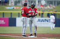 Carolina Mudcats manager Joe Ayrault (33) chats with Joe Gray Jr. (5) after he hit a triple during the game against the Kannapolis Cannon Ballers at Atrium Health Ballpark on June 9, 2021 in Kannapolis, North Carolina. (Brian Westerholt/Four Seam Images)