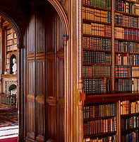 Carved panelling in a doorway connects  two of the library rooms
