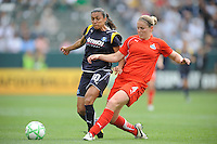 Los Angeles Sol (10) Marta can't stop Freedom's Cat Whitehillfrom kikcing the ball game against the Washington Freedom  at the Home Depot Center in Carson, CA on Sunday, March 29, 2009..
