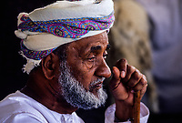 Oman.  Thoughtful Old Man Wearing his Msarr (Massar), with Walking Stick.