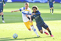 Jackson Yueill #14 San Jose Earthquakes fights for the ball with Gianluca Busio #27 of Sporting Kansas City