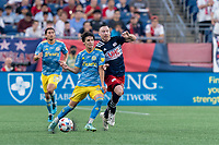 FOXBOROUGH, MA - AUGUST 8: Paxten Aaronson #30 of Philadelphia Union as Tommy McNamara #26 of New England Revolution pressures during a game between Philadelphia Union and New England Revolution at Gillette Stadium on August 8, 2021 in Foxborough, Massachusetts.