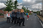 Brinsley Coffin Walk to Greasley Church, Nottinghamshire 2018. Joanne Hutsby from Gillotts Funeral Directors leads the walk from St James the Great Church built in1861.<br />