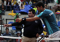 BOGOTA - COLOMBIA – 15 – 09 -2019: Franko Skugor de Croacia, habla con el arbitro, durante partido de la Copa Davis entre los equipos de Colombia y Croacia, partidos por el ascenso al Grupo Mundial de Copa Davis por BNP Paribas, en la Plaza de Toros La Santamaria en la ciudad de Bogota. / Franko Skugor of Croatia, speaks with the referee during a Davis Cup match between the teams of Colombia and Croatia, match promoted to the World Group Davis Cup by BNP Paribas, at the La Santamaria Ring Bull in Bogota city. / Photo: VizzorImage / Luis Ramirez / Staff.