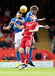 Aberdeen v St Johnstone…14.09.19   Pittodrie   SPFL<br />Craig Bryson loses out to Jason Holt and Murray Davidson<br />Picture by Graeme Hart.<br />Copyright Perthshire Picture Agency<br />Tel: 01738 623350  Mobile: 07990 594431