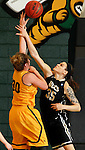 JANUARY 23, 2015 -- Brittany Hernandez #35 of UC-Colorado Springs fouls Cassidy Kotelman #30 of Black Hills State during their Rocky Mountain Athletic Conference women's basketball game Friday at the Donald E. Young Center in Spearfish, S.D.  (Photo by Dick Carlson/Inertia)
