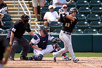 Pittsburgh Pirates Tony Wolters (93) bats during a Major League Spring Training game against the Minnesota Twins on March 16, 2021 at Hammond Stadium in Fort Myers, Florida.  Also shown is umpire Fieldin Culbreth and catcher Mitch Garver.  (Mike Janes/Four Seam Images)