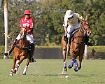 WELLINGTON, FL - FEBRUARY 12:  Diego Cavanagh #4 of Valiente II takes the ball down the field, while being pursued by Gillian Johnston #1 of Coca Cola, during Sunday's Feature Match vs Coca Cola at the International Polo Club, Palm Beach on February 12, 2017 in Wellington, Florida. (Photo by Liz Lamont/Eclipse Sportswire/Getty Images)