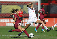 COLLEGE PARK, MD - OCTOBER 21, 2012:  Olivia Wagner (11) of the University of Maryland moves to block a shot by Tiana Brockway (15) of Florida State during an ACC women's match at Ludwig Field in College Park, MD. on October 21. Florida won 1-0.