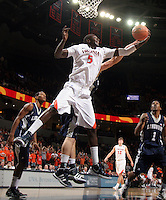 CHARLOTTESVILLE, VA- December 3: Assane Sene #5 of the Virginia Cavaliers grabs a rebound during the game against the Longwood Lancers on December 27, 2011 at the John Paul Jones Arena in Charlottesville, Virginia. Virginia defeated Longwood 86-53. (Photo by Andrew Shurtleff/Getty Images) *** Local Caption *** Assane Sene