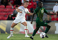 COLLEGE PARK, MD - SEPTEMBER 3: Maryland University forward Justin Gielen (9) shoots past George Mason University defender Jonathan Fawole (27) during a game between George Mason University and University of Maryland at Ludwig Field on September 3, 2021 in College Park, Maryland.