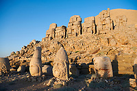 Statue heads, from right,  Eagle, Herekles & Apollo with headless seated statues in front of the stone pyramid 62 BC Royal Tomb of King Antiochus I Theos of Commagene, east Terrace, Mount Nemrut or Nemrud Dagi summit, near Adıyaman, Turkey