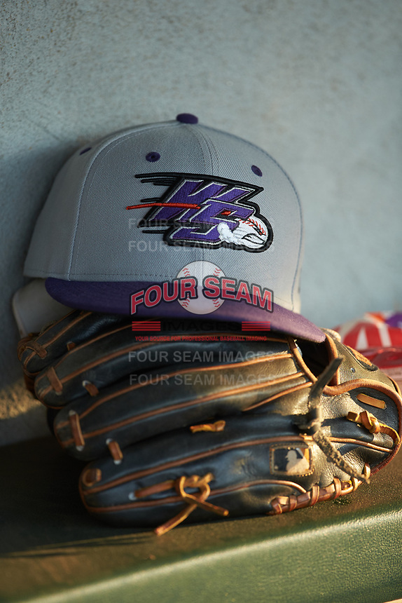 A Winston-Salem Dash cap sits on top of a glove in the vistor's dugout during the game against the Down East Wood Ducks at Grainger Stadium Field on May 17, 2019 in Kinston, North Carolina. The Dash defeated the Wood Ducks 8-2. (Brian Westerholt/Four Seam Images)
