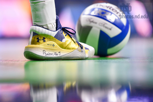 """March 26, 2021; Detail of Volleyball player shoe. Psalm 46:5 """"God is within her, she will not fall; God will help her at break of day."""" (Photo by Matt Cashore/University of Notre Dame)"""