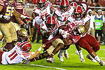 Florida State running back Khalan Laborn (4) keeps running as he's brought down by North Carolina State linebacker Payton Wilson (11) defensive tackle Alim McNeill and defensive tackle Larrell Murchison (92) in the first half of an NCAA college football game in Tallahassee, Fla., Saturday, Sept. 28, 2019.  (AP Photo/Mark Wallheiser)
