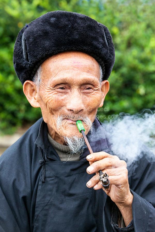 Matang, a Gejia Village in Guizhou, China.  Old Gejia Man Smoking his Pipe.