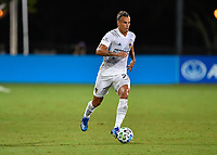 LAKE BUENA VISTA, FL - JULY 18: Rolf Feltscher #25 of LA Galaxy dribbles the ball during a game between Los Angeles Galaxy and Los Angeles FC at ESPN Wide World of Sports on July 18, 2020 in Lake Buena Vista, Florida.