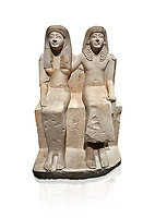 Ancient Roman statue of Pendua and his wife Nefertari, limestone, New Kingdom, 19th Dynasty, (1292-1186 BC),  Deir-el-Medina, Thebes. Egyptian Museum, Turin. white background.<br /> <br />  Carved in Thebian white limestone the statue of Pendua and his wife Nefertari shows the skill and attention to details of the sculptors of Deir-el-Medina, the worker's village of those who built the Royal Tombs at Thebes. The theme of the family is echoed by a carving of a daughter between the two figures.
