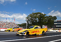 Jun. 2, 2013; Englishtown, NJ, USA: NHRA funny car driver Del Worsham (near lane) races alongside Paul Lee during the Summer Nationals at Raceway Park. Mandatory Credit: Mark J. Rebilas-