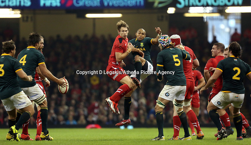 Pictured: Liam Williams of Wales (C in red) clashing against Cornal Hendricks of South Africa (C in green) Saturday 29 November 2014<br /> Re: Dove Men Series 2014 rugby, Wales v South Africa at the Millennium Stadium, Cardiff, south Wales, UK.