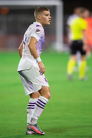 LAKE BUENA VISTA, FL - AUGUST 06: Chris Mueller #9 of Orlando City SC waiting on the ball during a game between Orlando City SC and Minnesota United FC at ESPN Wide World of Sports on August 06, 2020 in Lake Buena Vista, Florida.