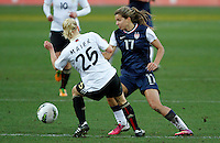 US's Tobin Heath fights for the ball with Germany's Leonie Maier during their Algarve Women's Cup soccer match at Algarve stadium in Faro, March 13, 2013.  .Paulo Cordeiro/ISI