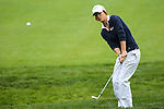 England's Melissa Reid uses her iron to chip the ball onto the seventh green at the LPGA Championship at Locust Hill Country Club in Pittsford, NY on June 7, 2013