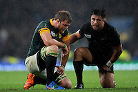 Keven Mealamu of New Zealand sympathises with Duane Vermeulen of South Africa at the end of the Semi Final of the Rugby World Cup 2015 between South Africa and New Zealand - 24/10/2015 - Twickenham Stadium, London<br /> Mandatory Credit: Rob Munro/Stewart Communications