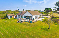 BNPS.co.uk (01202 558833)<br /> Pic: LillicrapChilcott/BNPS<br /> <br /> Pictured: The house.<br /> <br /> Homebuyers can get the best of coast and country with this spectacular house on the market for offers in excess of £1.5m.<br /> <br /> Westfield sits in an incredible position with views over its own land and the sea at Trevaunance Cove in Cornwall.<br /> <br /> The four-bedroom family home is on the edge of the sought-after village of St Agnes, popular with locals, second home owners and holidaymakers.<br /> <br /> The hub of the home is the open-plan kitchen/family room with a folding door that opens up to the sea-facing terrace.