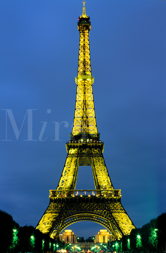 The Eiffel Tower illuminated at night .