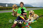Judi Pheysey sits with Marcelle the ambassador Irish Guide Dog, Freda her puppy in training and Vyda as the Tralee Branch of the Irish Guide Dogs for the Blind launch their Kite Fest in Tralee on Tuesday.