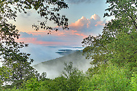 Foggy sunset over the Blue Ridge Mountains from the Blue Ridge Parkway in Virginia. Photo/Andrew Shurtleff