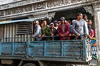 Workers on way to jobs in Havana.