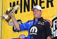 Jul, 22, 2012; Morrison, CO, USA: NHRA pro stock driver Allen Johnson celebrates after winning the Mile High Nationals at Bandimere Speedway. Mandatory Credit: Mark J. Rebilas-US PRESSWIRE