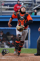 Norfolk Tides catcher Luis Exposito #12 during a game against the Empire State Yankees at Dwyer Stadium on April 22, 2012 in Batavia, New York.  Empire State defeated Norfolk 6-5, the Yankees are playing all their games on the road this season as their stadium gets renovated.  (Mike Janes/Four Seam Images)