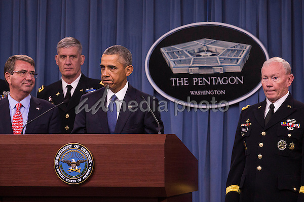 United States President Barack Obama delivers remarks after meeting with members of his national security team concerning ISIS at the Pentagon in Washington, D.C. on Monday, July 6, 2015. From left, Secretary of Defense Ashton Carter, Commander of U.S. Africa Command Gen. David Rodriguez, and Chairman of the Joint Chiefs of Staff U.S. Army General Martin Dempsey. Photo Credit: Drew Angerer/CNP/AdMedia