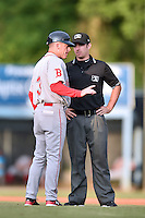 Greenville Drive manager Darren Fenster (3) discusses the previous play with umpire Donnie Smith during a game against the  Asheville Tourists at McCormick Field on June 3, 2016 in Asheville, North Carolina. The Tourists defeated the Drive 6-5. (Tony Farlow/Four Seam Images)
