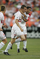 June 15, 2005; Washington, DC, USA; Chicago Fire forward Nate Jaqua (11, left) celebrates his goal with teammate Ivan Guerrero (23, right) at RFK Stadium.  DC United won the game, 4-3.