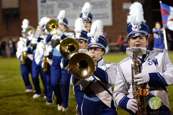 Members of South Williamsport High School Marching Band perform at a football game.