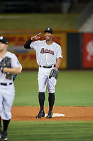 Birmingham Barons left fielder Eloy Jimenez (21) celebrates with his teammates after a game against the Pensacola Blue Wahoos on May 8, 2018 at Regions FIeld in Birmingham, Alabama.  Birmingham defeated Pensacola 5-2.  (Mike Janes/Four Seam Images)