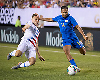 PHILADELPHIA, PA - JUNE 30: Kenji Gorre #14 attacks as Jordan Morris #11 defends during a game between Curaçao and USMNT at Lincoln Financial Field on June 30, 2019 in Philadelphia, Pennsylvania.