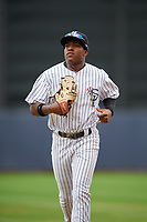 Staten Island Yankees center fielder Alex Junior (29) jogs back to the dugout during a game against the Lowell Spinners on August 22, 2018 at Richmond County Bank Ballpark in Staten Island, New York.  Staten Island defeated Lowell 10-4.  (Mike Janes/Four Seam Images)