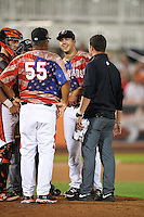Aberdeen Ironbirds pitcher Daniel Ayers (25) talks with manager Luis Pujols (55) and trainer Brian Guzman as catcher Chris Shaw (58) looks on during a game against the Tri-City ValleyCats on August 6, 2015 at Ripken Stadium in Aberdeen, Maryland.  Tri-City defeated Aberdeen 5-0 in a combined no-hitter.  (Mike Janes/Four Seam Images)