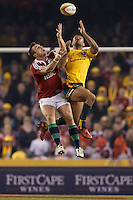 MELBOURNE, 29 JUNE 2013 - Tommy BOWE of the Lions and Kurtley BEALE of the Wallabies fight for the ball during the Second Test match between the Australian Wallabies and the British & Irish Lions at Etihad Stadium on 29 June 2013 in Melbourne, Australia. (Photo Sydney Low / sydlow.com)