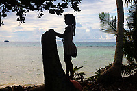 A young girl looks out onto the Funafuti lagoon, in the Tuvaluan capital. Located in the South West Pacific Ocean, Tuvalu is the world's 4th smallest country and is one of the most vulnerable to climate change impacts including sea level rise, drought and extreme weather events. Tuvalu - March, 2019.