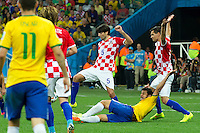 Fred of Brazil is brought down for a penalty