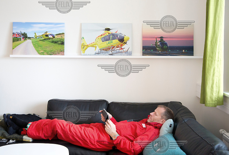 Pilot Jan Nielsen relaxing between missions. Denmarks first  air ambulance serivce, operated by Norwegian Air Ambulance. The crew is pilot Jan Nielsen, HEMS paramedic Lars Greve-Wilms and doctor Rikke Helene Rasmussen. <br /> <br /> The crew operate an Airbus EC-135 out of the Ringsted base, one of three bases in Denmark.