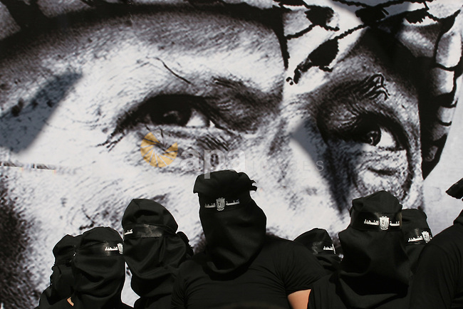 Palestinian students supporters of the Fatah movement during a celebrating in the 9th anniversary of the death the late Palestinian President Yasser Arafat at al-Najah University in the West Bank city of Nablus, on Nov. 10, 2013. Photo by Nedal Eshtayah